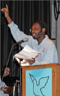 Aly Wane speaking before the Noam Chomsky talk in May of 2011. Photo: Ray Trudell