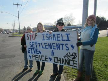December 15, 2012 demonstration on Erie Blvd against expansion of Israeli settlements. Banner by Weston Hoy. Photo: Jessica Azulay