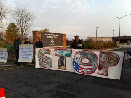 Drone resisters attempted again on October 25 to deliver an indictment for war crimes to personnel at Hancock Airbase. 17 people were arrested as they blocked all three gates to the base (see SPC in Action, PNL #819). Photo: Ellen Grady