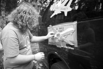 Max Novack prepares the Drone Country Tour van. Photo: Brandon Weight